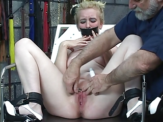 Guy Gives Hot Blonde In Bondage Pain On The Table