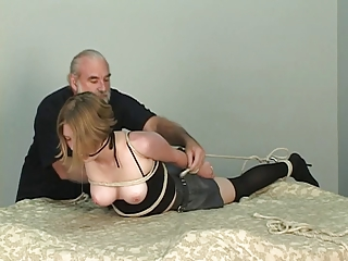 Short Hair Honey In Bondage On Table