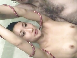 Asian Babe Roped Up And Covered In Cream